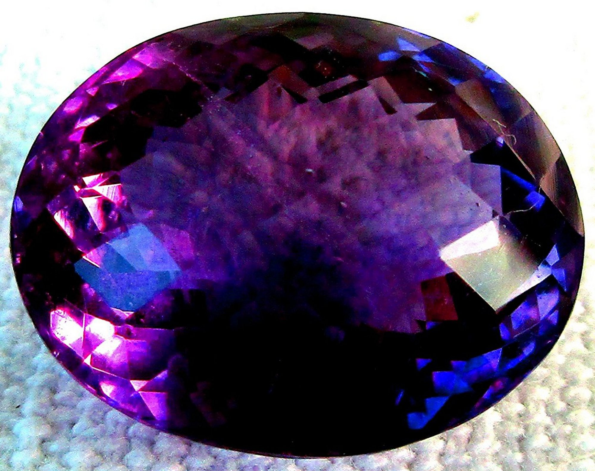under content viewed when purple diamond article secondary international rarer blue bright high than its ten with paraiba color copper gemstones gem gemstone hues society magnification creates a ring